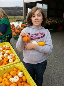 My cutie with her collection of cute pumpkins.