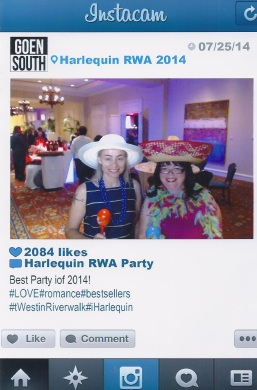 Jenn and I make use of the Instacam at the Harlequin party.